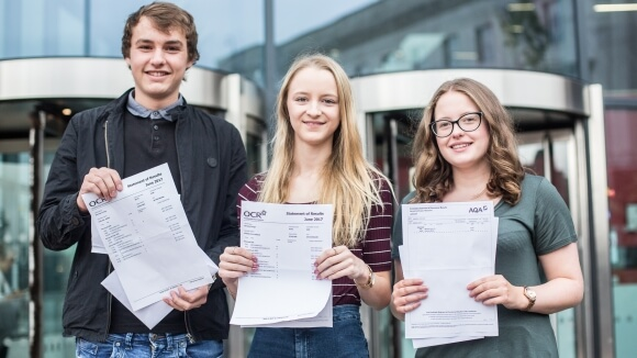 Students James Carlow, Ella Spence and Maddie Jewitt with their results