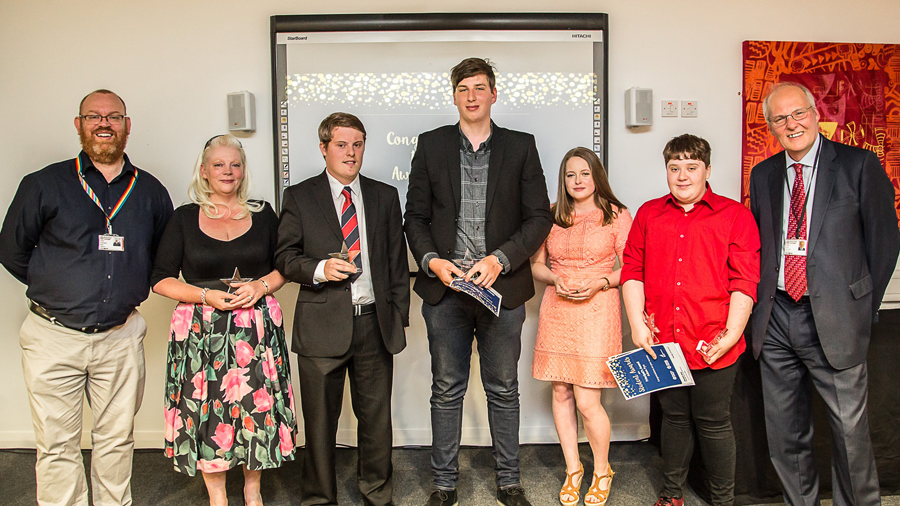 Principal, Chris Webb with award winners (left to right) Michelle Tingle, Corey Hurley, Connor Padgett, Maddie Jewitt, Adam Pye and Chair of Governors, Simon Perryman.