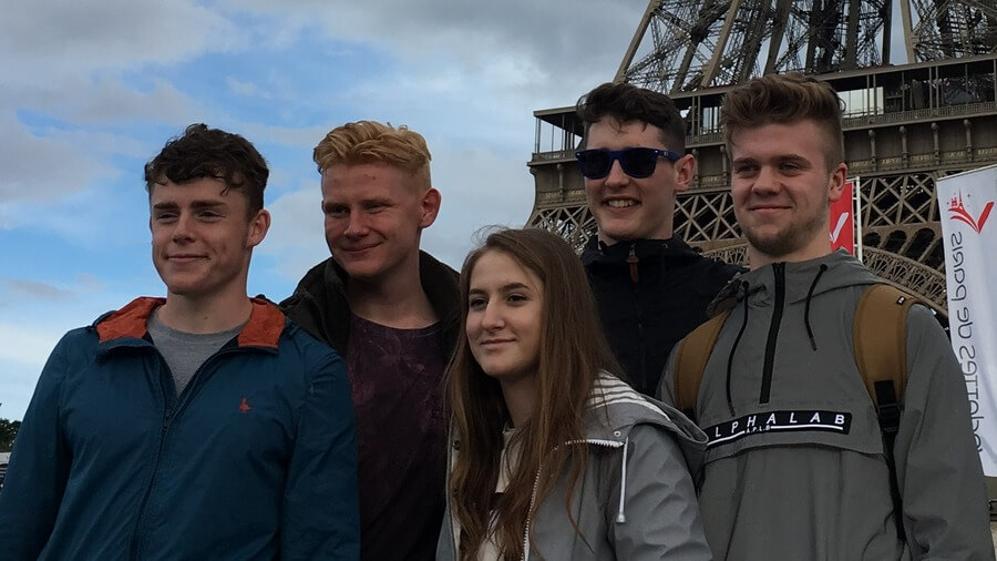 Students Daniel Hayward, Jake Frost, Hannah Cordingley, Kyle Matthews and Callum Fieldsend visiting the Eiffel Tower.